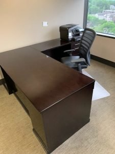 used L-shaped desk with task chair