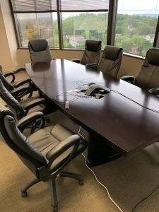 used conference table with modern style chairs
